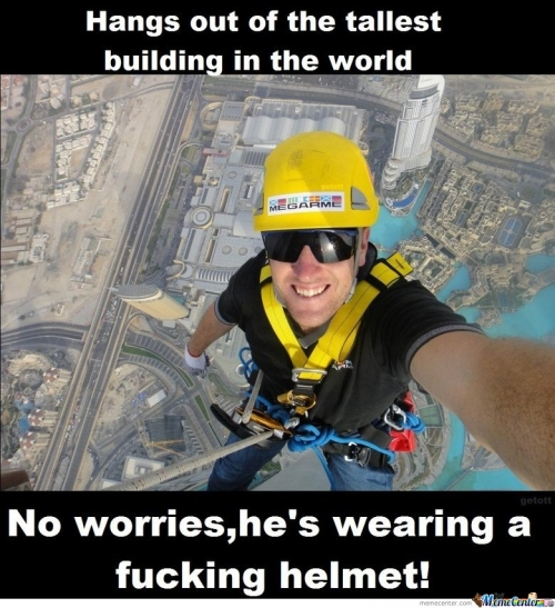 Hangs out of the tallest building in the world , no worries he's wearing a  helmet