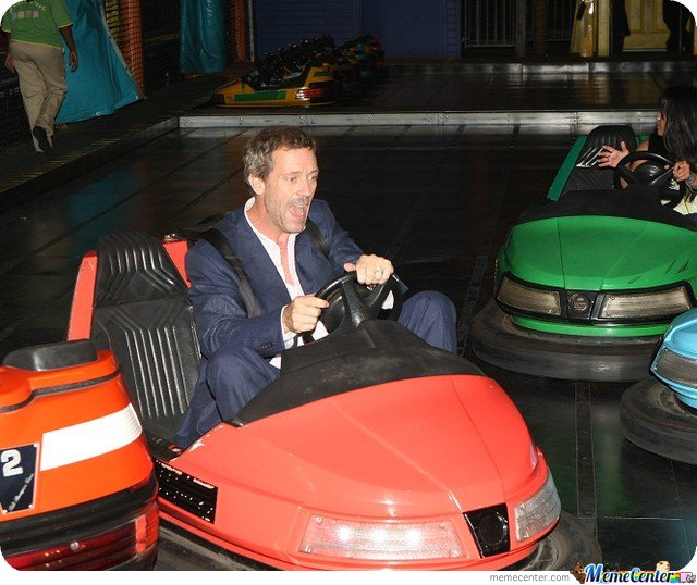 Hugh Laurie driving a bumper car.