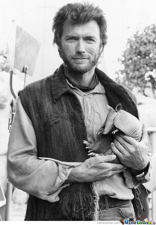 Young Clint Eastwood holding a young armadillo