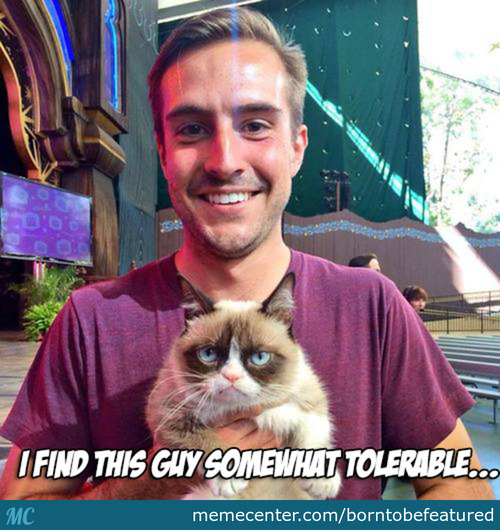 Ridiculously Photogenic Guy Meets World's Grumpiest Cat.