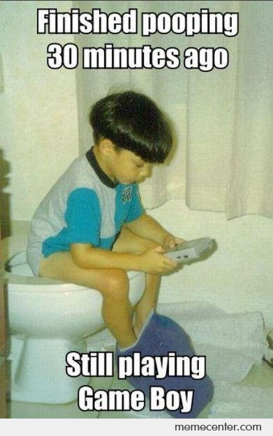 Playing Game Boy While Pooping