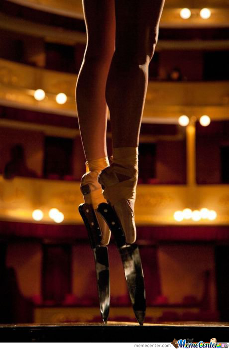Ballerina Performs En Pointe With Knife Shoes.