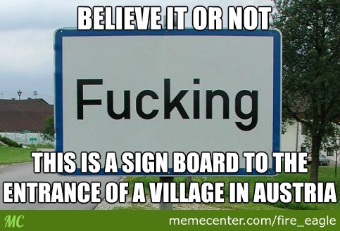 The Name Of The Village Is On The Sign Board